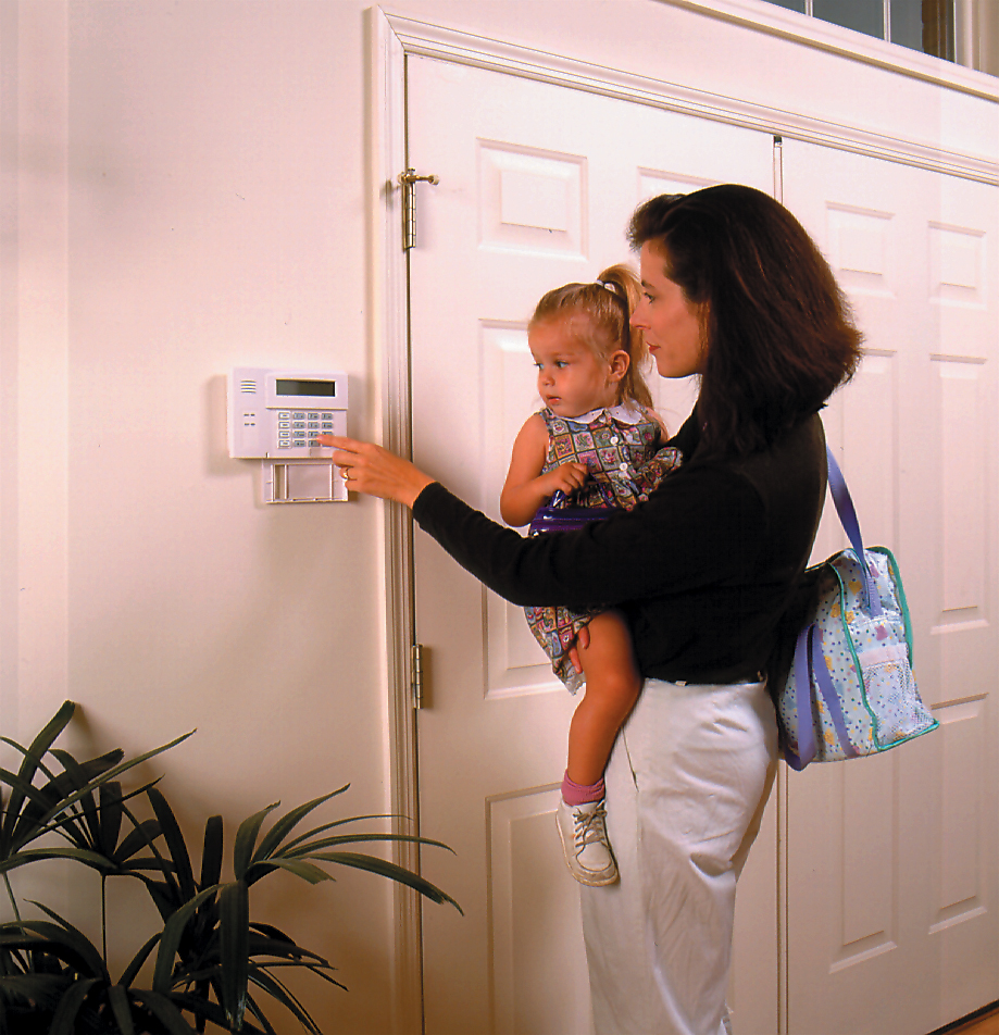 Mother activating home security system